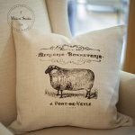 White pillow with black ink stenciled sheep