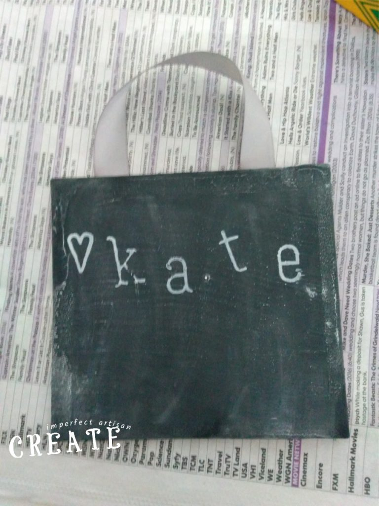 small black chalkboard with a white heart and the name Kate printed on it