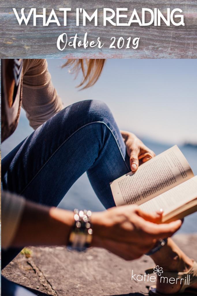 woman reading next to a lake